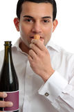 Man or wine steward sniffing wine cork Stock Photos