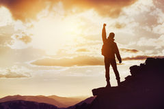 Man winner mountain top silhouette. Silhouette of man in winner pose on mountain top. Win concept with space for text Royalty Free Stock Images