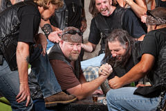 Man Winning Arm Wrestling Match Stock Photography