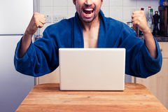 Man winning at home Royalty Free Stock Photos