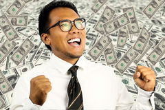 Man winning the lottery. Businessman happy to have won the lottery royalty free stock photography