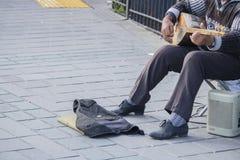 Man winning money with instrument royalty free stock image