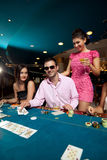Man winning poker three of a kind formation Stock Images