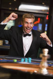 Man winning at roulette table. Man winniing at roulette table in casino royalty free stock photo