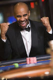 Man winning at roulette table. In casino royalty free stock images