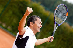 Man winning at tennis Royalty Free Stock Image