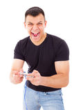 Man winning video game playing with joystick Royalty Free Stock Photography