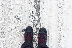 Man in winter boots standing in snow Royalty Free Stock Photo