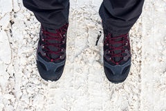 Man in winter boots standing in snow Stock Photos