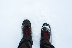 Man in winter boots standing in snow Stock Image