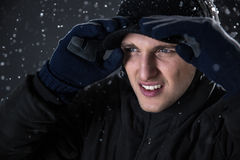 Man in winter cloth looking away Royalty Free Stock Photos