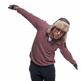 Man in winter clothes is impersonating an airplane. Playful young man in winter clothes is impersonating an air plane Royalty Free Stock Photography