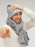 Man in winter clothes pointing his finger Stock Images