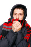Man in winter clothes shivering from the cold