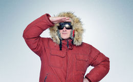 Man in winter clothes and sunglasses Stock Image