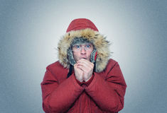 Man in winter clothes warming hands, cold, winter Stock Images