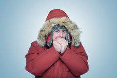 Man in winter clothes warming hands, cold, winter. On background Royalty Free Stock Photos
