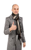 Man in a winter clothing. Handsome young man in a winter clothing with positive attitude. Isolated on white background royalty free stock image
