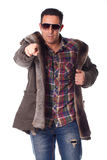 Man in a winter clothing and pointing Stock Photo