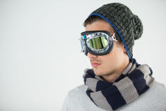 Man in winter clothing wearing aviator goggles Royalty Free Stock Photos