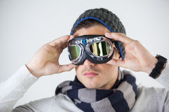 Man in winter clothing wearing aviator goggles Stock Images