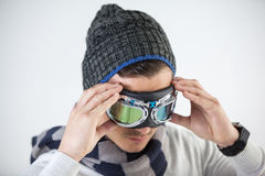 Man in winter clothing wearing aviator goggles Royalty Free Stock Photo