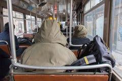 Man in winter coat sitting in tram Stock Images