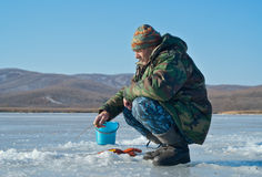Man on winter fishing 53 Stock Photography
