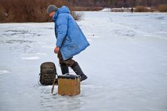 Man on winter fishing in February royalty free stock photo