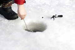 A winter fishing. A man on winter fishing on ice of river Stock Photography
