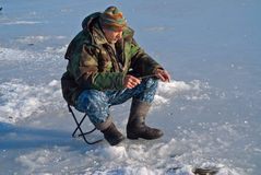 Man on winter fishing 21 Stock Image