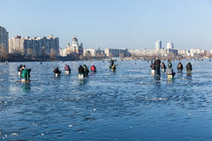 Man on winter fishing, people on the ice of the frozen lake, fis Stock Photography