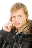 Man in winter jacket speaks on phone Royalty Free Stock Photos