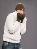 Man in winter mittens and hat Royalty Free Stock Images