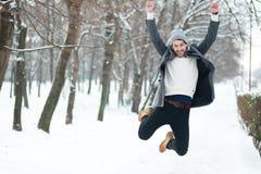 Man on winter park Stock Photos
