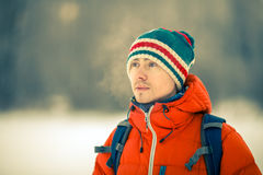 Man in winter at park. Portrait of man in hat with backpack in winter at park Royalty Free Stock Photo