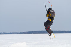 Man winter snowkiting Stock Images