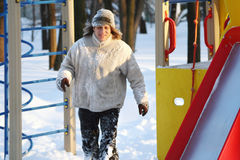 Man in winter to run and play on the playground stock photo