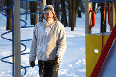 Man in winter to run and play on the playground royalty free stock photography