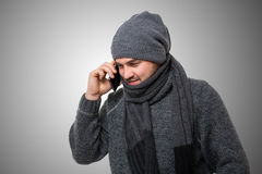 Man in winterwear talking on the phone Royalty Free Stock Photos