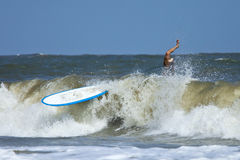 Man wipeing out on surfboard Royalty Free Stock Photography