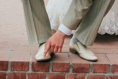 Man wipes shoe. Man wipes his shoes with his finger Stock Photography