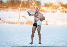 Man wipes towel after swimming in  freezing Stock Images
