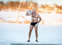 Man wipes towel after swimming in  freezing Stock Photo