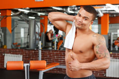 Man wiping himself with towel in gym Stock Photos