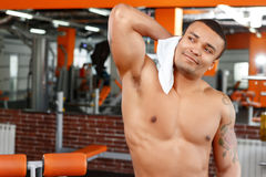 Man wiping himself with towel in gym Stock Photo