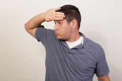 Man wiping his sweat Stock Photography