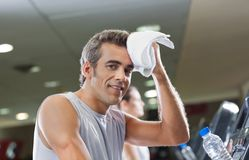 Man Wiping Sweat With Towel At Health Club Stock Photography