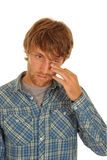 Man wiping tears from eye Stock Photo
