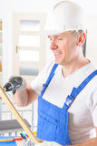 Man with wireless electric drill Royalty Free Stock Images